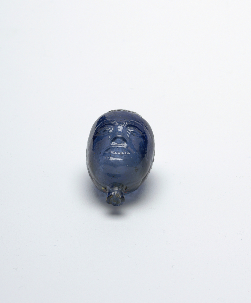 blue glass, head shaped vessel.