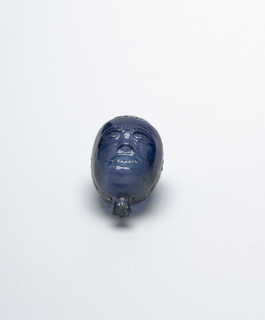 blue glass, head shaped vessel.