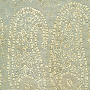 White-on-white embroidered shawl in a sheer fabric with an Indian style border of four floral motifs in large boteh or paisley shapes at each end. Sparsely dotted field with embroidered scalloped edge capped with flowers on all four sides.