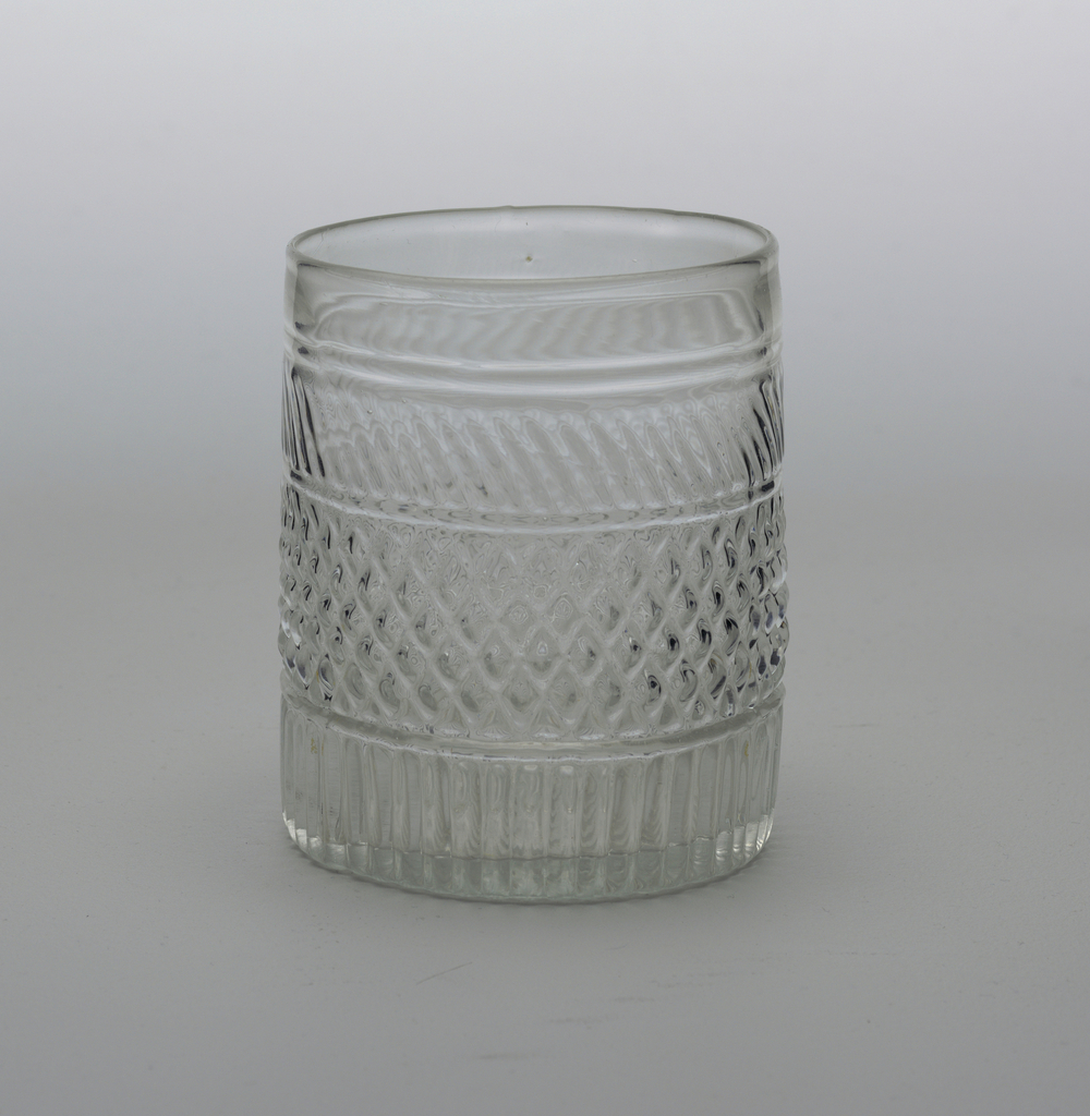 3-part mold blown beaker with central band of diamonds, a band of blazes show and vertical fluting below, pontil mark on bottom with rayed fluting spreading out from it.