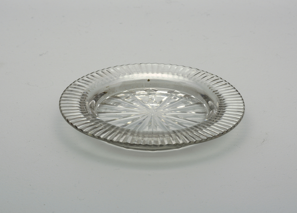 Small cirucular plate with flat fluted rim, star cut on center bottom.