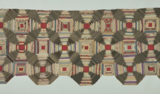 Quilt piece made from groups of multicolored concentric octagons in woven and printed fabrics. Mainly in gray, dull green and reddish tones.
