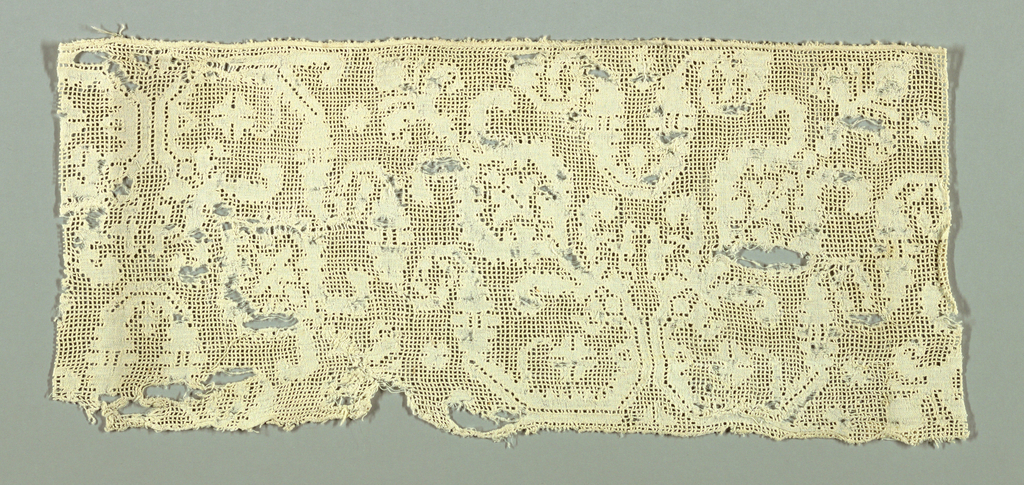 Fragment with a design of angular stems with motifs of two conventionalized flowers in a diagonal arrangement, placed alternately, up and down. Design left in reserve with a background of small squares of tightly wrapped threads.