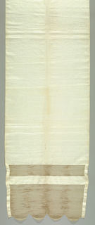 White linen towel with two unpatterned openwork panels at both ends. End panels are scalloped.