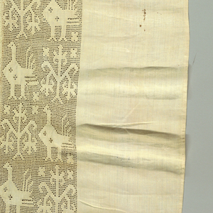 Panel edged on one side with a border showing a design of birds and flowers.