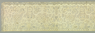 Oblong panel with elaborate patterns of drawn work with the main elements of the design reserved in the linen ground. Embroidered outlines and details. Symmetrical design of curving lines, flowers and vines originating from central motif. Lower edge trimmed with bobbin lace.
