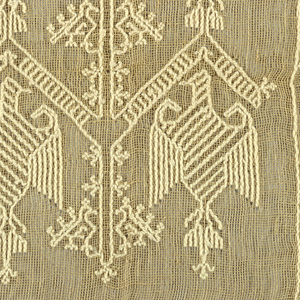 Natural color open weave linen, embroidered in coarse white cotton' pattern of eagles in two rows; simple border of star shapes