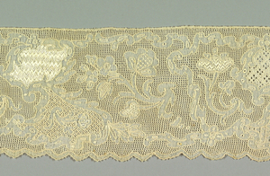 Border with a pattern of floral sprays and sprigs. Small fields of various lace and embroidery stitches.