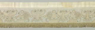 Long narrow border of very fine white cotton ornamented with drawn work, embroidery in white, gold thread, black silks and gold fringe at bottom set onto narrow brocaded ribbon on top. Design consists of a double-headed eagle between peacocks with small birds below. Bodies of birds and wings worked in a great variety of designs in very fine drawn work, geometric patterns, embroidered over in white, outlines in gold thread, bird's eyes in black silk. Seven repeats of this group and in each one drawn work designs are different.