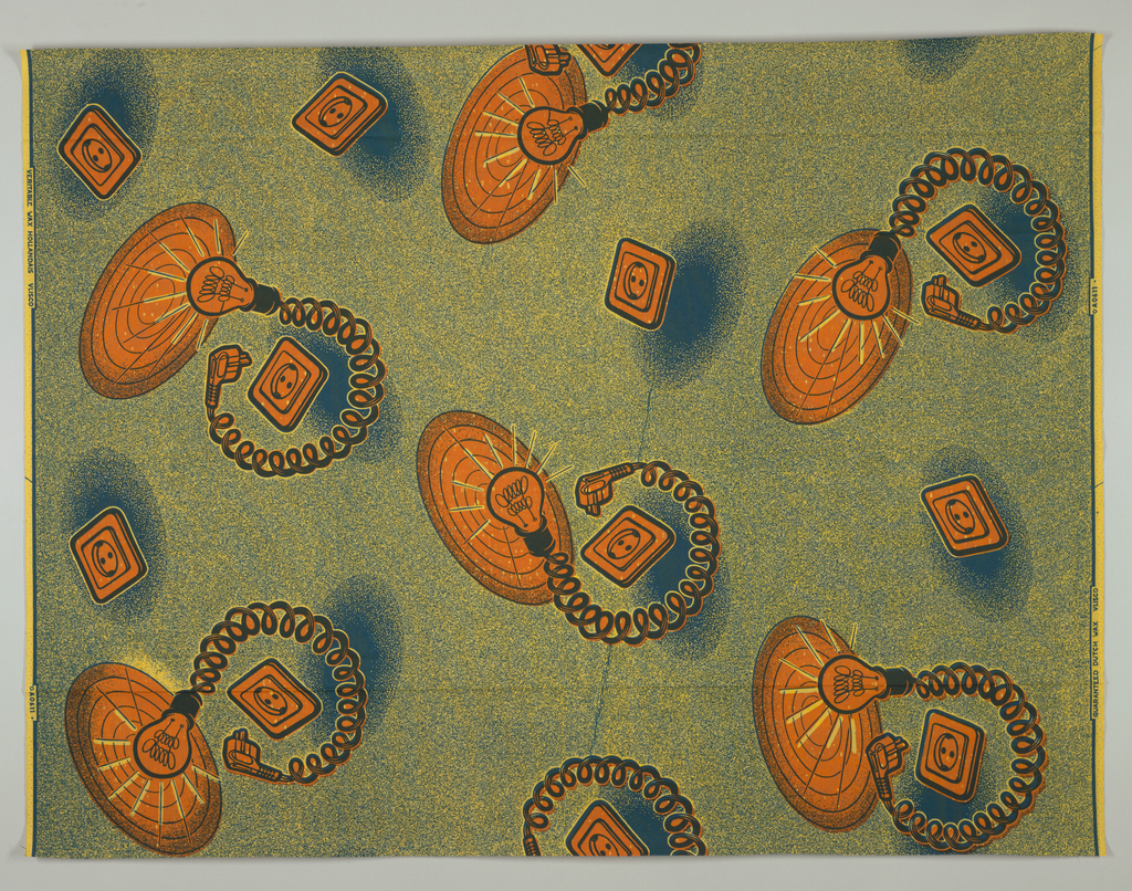 Lightbulbs and electrical outlets on a speckled ground. Printed in indigo and orange on a dyed yellow ground.