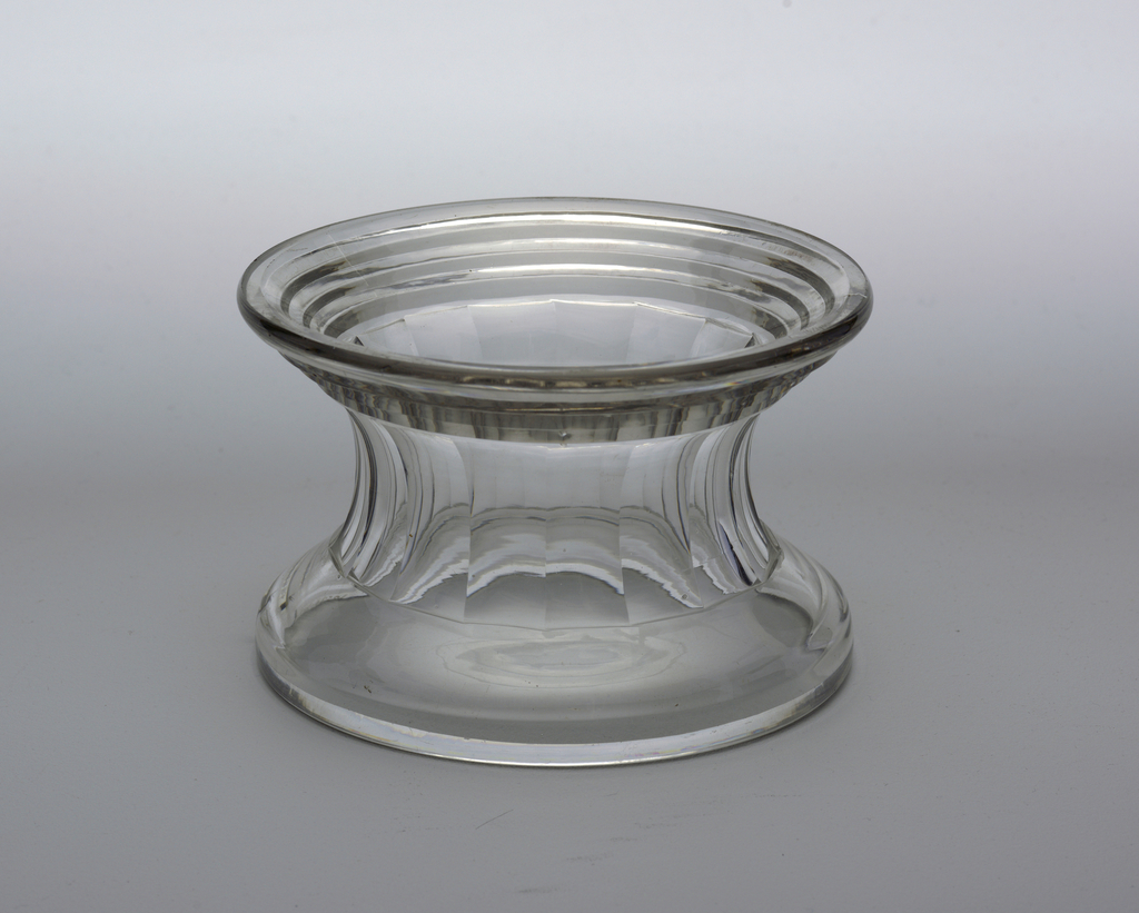 Spool-shaped with vertical fluting around center, prismatic rings around bottom.