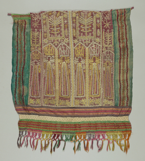 "Textile with center panel of raffia sandwiched between a layer of red silk (front) and a layer of yellow-green twill silk. Heavily embroidered in geometrized units of ""tree of life"" animals and tall crowned figures in couched gold and silver metallic yarns; use of pailettes all over. Edged on three sides with silk gauze striped with supplementary warp bands. Bottom shows knitted cotton lace insertion. Silk fringe at bottom. Loops at sides on top."