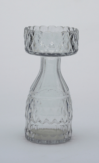 Ovoid body tapers to fluted neck, wide flat lip with turned-up rim and scalloped border; body and upper rim cut with diamonds, pillar flutes at base. Hyacinth