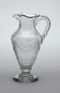 """Urn-shaped body, tapered neck, shaped lip with pouring spout, loop handle with 2 rows of cut facets along sides; sides decorated with engraved decoration of swags, flowers and the initials """"S A N"""" under spout, fluting above and below; tapered foot on spool stem and flat disk-shaped base with faceted edge."""