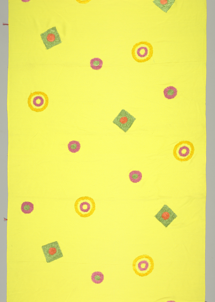 Machine embroidered concentric circles and circles within a square using a fuzzy yarn in pink, yellow, green, and orange on a bright yellow background.