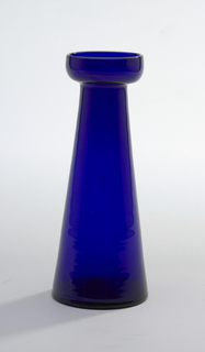 Tall cylindrical body tapers towards neck, wide flat lip with turned-up rim, amethyst-colored glass. Hyacinth