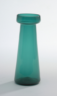 Tall cylindrical body tapering towards neck, wide flat lip with turned-up rim; green colored glass. Hyacinth