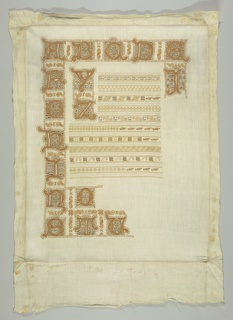 Fifteenth century style letters and rows of cross borders in brown and tan on a white ground fabric. Copied from a liturgical book.