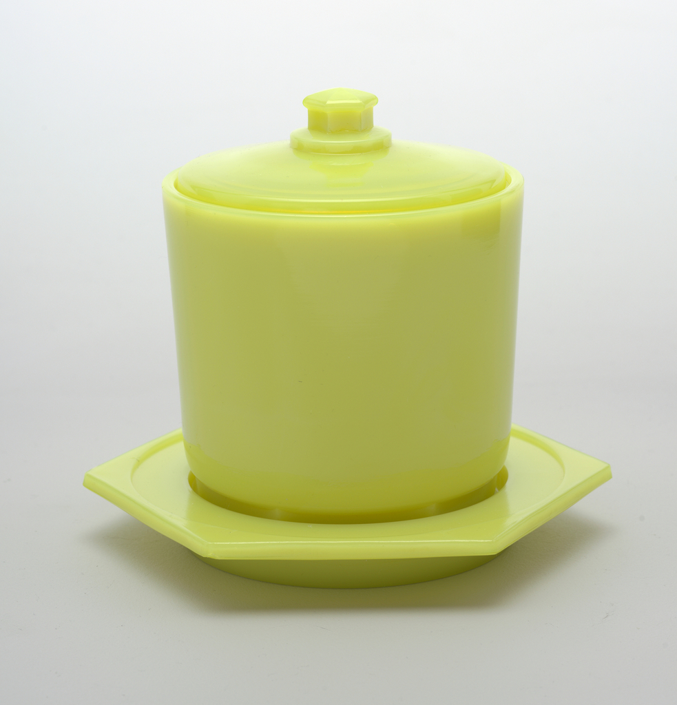 Yellow, cylindrical, with lid and fitted tray.
