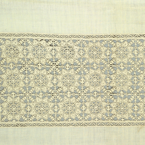 White cover with a wide reticella border worked with three rows of stars at each end. Narrow border in the same design at the sides. Deep pointed bobbin lace at the ends and and narrower bobbin lace eding at the sides.