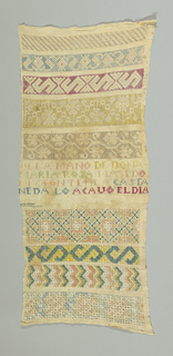 Nine bands of withdrawn element work embroidered with colored silks in geometric designs. Inscription in center.