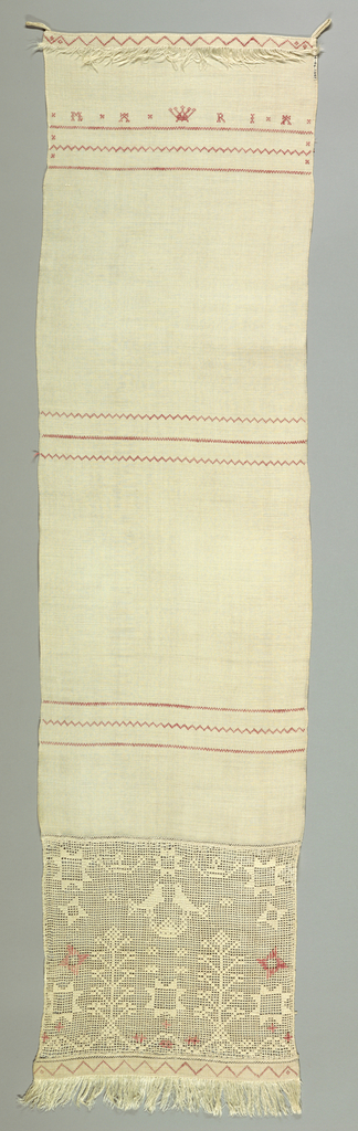 """Towel cover ornamented with the """"Maria,"""" crowns and cross borders of a straight line set between zigzags worked in cross stitch. Above is a band of drawnwork with birds, crowns, stars, and flowers in darning and overcasting. Fringe at top and bottom."""