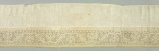 Panel edged on one side with a wide border in a design showing a conventionalized vine pattern. Trimmed with bobbin lace.