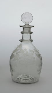 Bulbous lightly blown body, 2 neck rings-knotched, everted lip, row of everted lip, row of faint molded vertical fluting bottom of sides, above engraved with a rose, thistle and shamrock; target-shaped stopper with waffle pattern; pontil mark surrounded by makers mark (faint) and light fluting to edges.