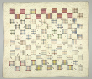 """Crib quilt in """"One Patch"""" pattern, made from plain white cotton, woven plaids, and white cotton with a printed rose pattern. Quilted in a simple diamond design. Plain white backing."""