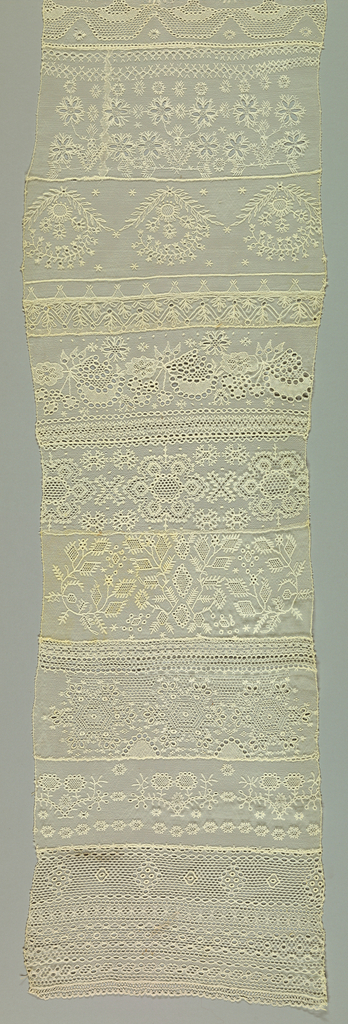 Twelve designs worked as cross border; edged at top and bottom with narrow bobbin lace.