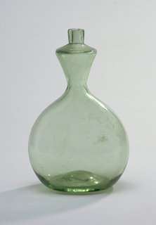 Hand-blown, some bubbles. Spheroid body with broad base, depressed on underside and domed slightly in interior. Body flattened from front, thickest part at base, and diminishing toward neck. Body curves at top into funnel-shape, about one-third height of body, covered by sloping shoulders and short cylindrical neck with small circular aperture.