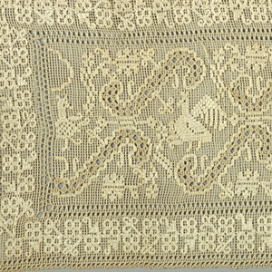 Rectangular selvage to selvage gauze weave with birds enclosed within a grid composed of scrolls and leaves. Floral outer border. Narrow woven band with long weft-loop fringe attached to two narrow sides.