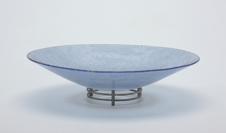 Light blue glass bowl on a metal stand