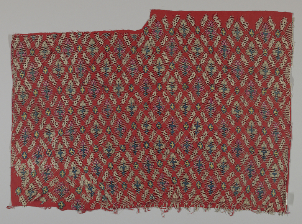 Large fragment with a diamond pattern in multi-colored silk on a very open knotted net.