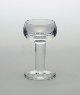 Clear transparent globular cup on thick solid cylindrical stem with flat circular foot.