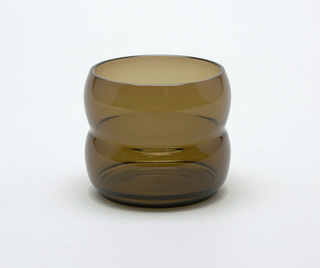 Smokey-brown transparent cylindrical body of two convex sections, one above the other.