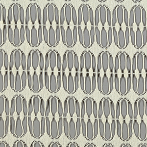 Ivory non-woven casement fabric patterned by rows of diamonds between slender verticals.