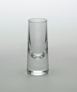 Clear transparent slightly conical cylinder form with thick solid  base.