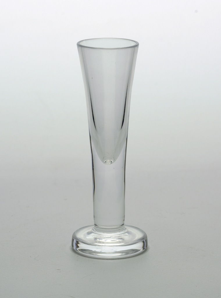Clear transparent cylindrical form tapering down to thick circular foot.