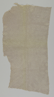 Netting used as World War II camoflage. The material is tan and has an open mesh.