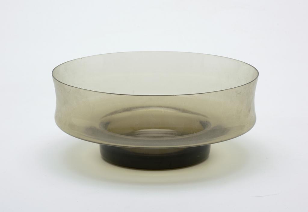 Transparent smokey brown circular bowl with concave wall and short circular base.
