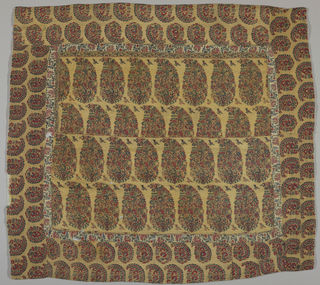 Square shawl made from shawl fragments and pieces. Central square is made of two border fragments, each with two rows of floral cones and small birds in profile on a light yellow ochre ground. Surrounding central square is a narrow border made from fragments with red and yellow flowers and blue and green leaves and stems on a white ground. Outer border is comprised of two rows smaller floral cones on a light yellow ochre ground. Shawl is made up of many fragments, especially the outer border.