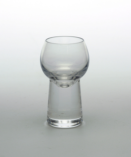 Clear transparent ovoid cup on  thick solid slightly tapering cylindrical base.