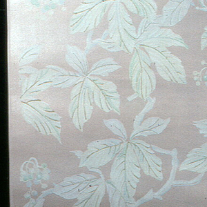 An allover design of white, cream, and pastel blue and green five petalled leaves and berries with connecting stems on a pale pink ground with satin finish.