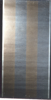 Imitation of a grasscloth with a horizontal texture. Brown and blue in 4 inch vertical stripes on an eggshell background.