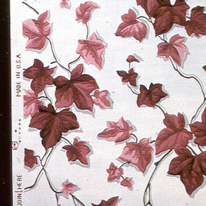An all-over ivy pattern of red leaves on a cream ground.