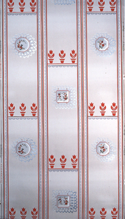 Vertical grey stripes containing horizontal row of red tulips and a red, white, and metallic silver medallion on a cream ground.
