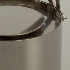 Stainless steel cylindrical ice bucket with a double basket handle.