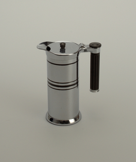 Service pieces are chrome cylindrical with some horizontal striations; handles composed of black fluted cylinders.