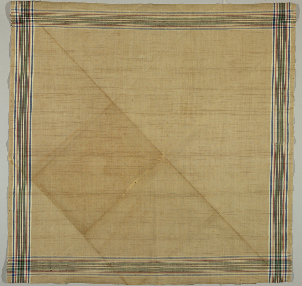 Light tan ground with narrow border stripes of blue, rose, green, purple, brown and white.